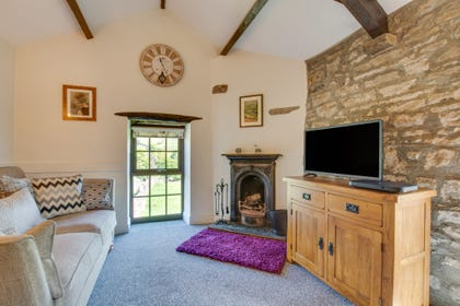 Lounge with open fire and views over the Dale