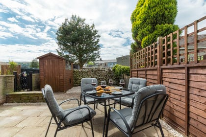 The enclosed rear courtyard, ideal for dining al fresco