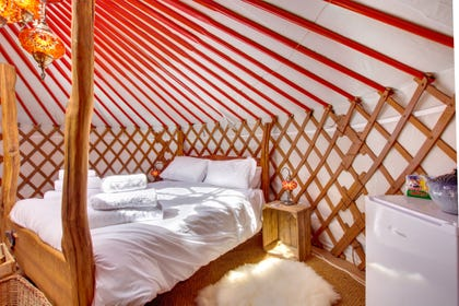 King-size hand crafted bed at Oystercatcher Yurt