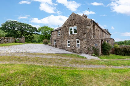 Large stone built property with parking to the side and views over the beautiful countryside