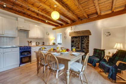 Spacious dining kitchen with wood burning stove and comfortable seating
