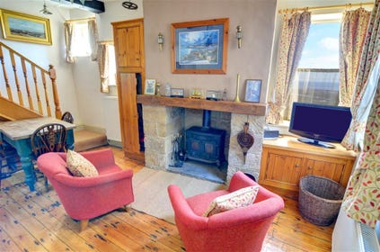 The Kitchen also has a cosy seating area with an open fire and TV.
