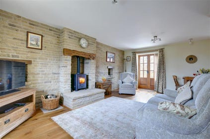 Comfortable, cosy lounge with wood-burning stove.