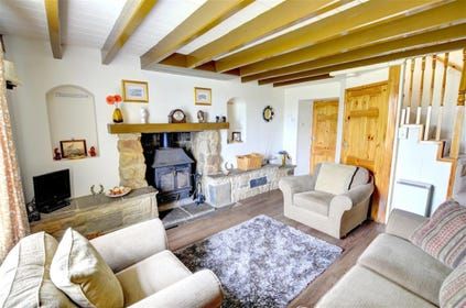 The cosy Lounge features a wood-burning stove.