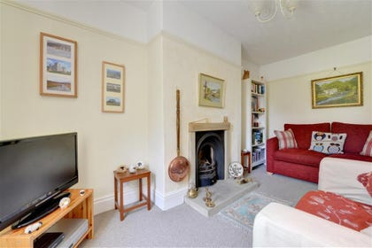Lounge with comfortable seating, TV and gas fire.